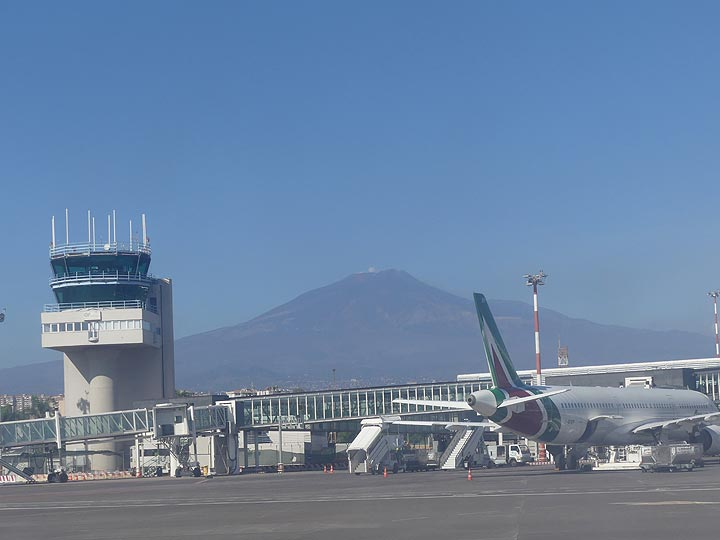The imposing ca 3320 m high mountain that is Etna volcano dominates the skyline of Catania airport. (Photo: Ingrid Smet)