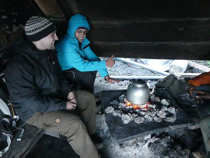 Day 3 - At ca. 3400 m asl it can be rather cold, humid and windy on the volcano´s summit - but there is always a fire burning and some hot tea in our ´dining room´ (Photo: Ingrid Smet)