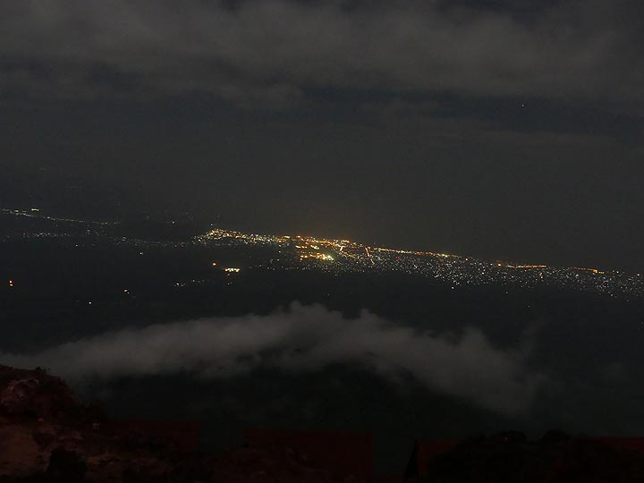 Day 3 - When the clouds around the summit are gone, we can see the lights of Goma city at the shore of Lake Kivu (Photo: Ingrid Smet)