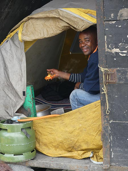 Day 4 - Our camping cook Benjamin doing his magic in a small tented kitchen (Photo: Ingrid Smet)