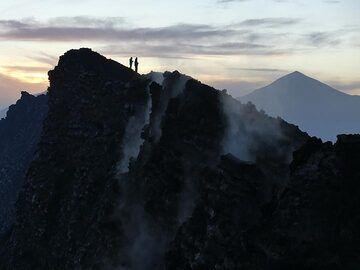 Day 5 - Watching the sun rise between Mikeno and Karisimbi (right) volcano (Photo: Ingrid Smet)