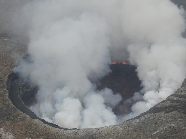 Day 5 - Nyiragongo´s lava lake during the day time is often partially obscured by the gas plumes it emanates (Photo: Ingrid Smet)