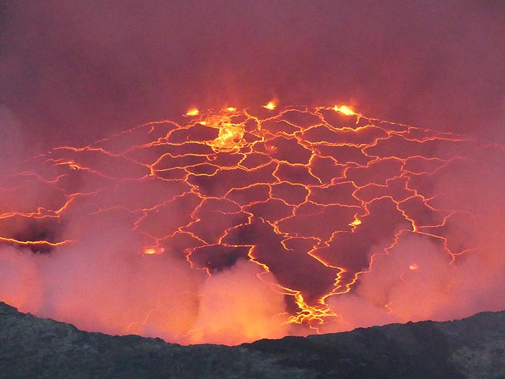 Day 5 - Sunset pink hues of the lava lake´s glow reflected on the gas plumes (Photo: Ingrid Smet)