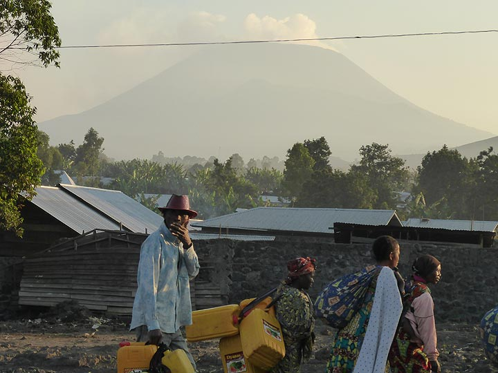 Day 7 - Nyiragongo towers over the city of Goma and its inhabitants starting out on a new day (Photo: Ingrid Smet)