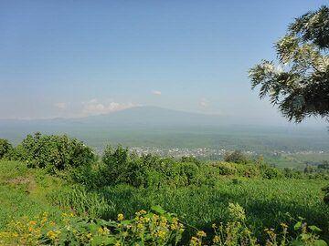 Day 7 - Hazy silhouette of Nyamuragira, Nyiragongo´s volcanic neighbour which is an active shield volcano (Photo: Ingrid Smet)