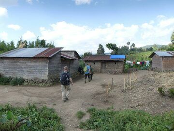 Day 7 - Hiking back to the starting point for the gorilla tracking, through small local villages (Photo: Ingrid Smet)