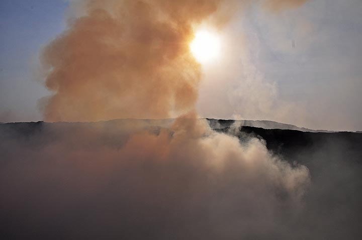 The morning sun piercing through the steam clouds and volcanic gasses rising up above the south vent in the summit caldera (Photo: Anastasia)