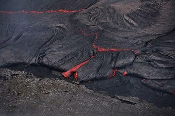 Close up of the cooled black crust atop an active lava flow at the new fissure eruption site (Photo: Anastasia)
