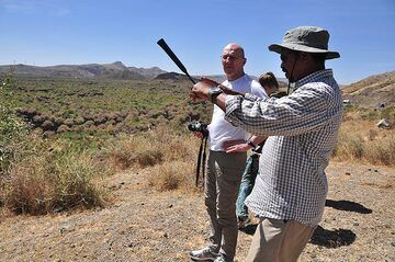 Our expedition organiser and Ethiopian geologist Enku explaining the formation of volcanic features in the landscape (Photo: Anastasia)