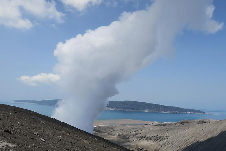 The island of Sertung seen behind the steam plume from the crater lake. (Photo: AndreyNikiforov)