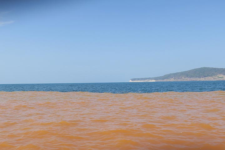 Orange-colored sea water due to suspended particles in front of Anak Krakatau's western shore where the active crater lake is located. (Photo: AndreyNikiforov)
