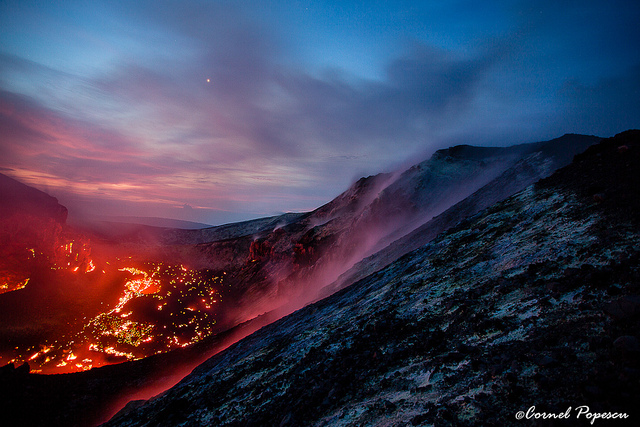 Anak Krakatau as seen from the summit on 7 May 2012. Everything is lit up in a surreal red-pink colour - the sky, the lava, the hot gases rushing out of the cone. (c)