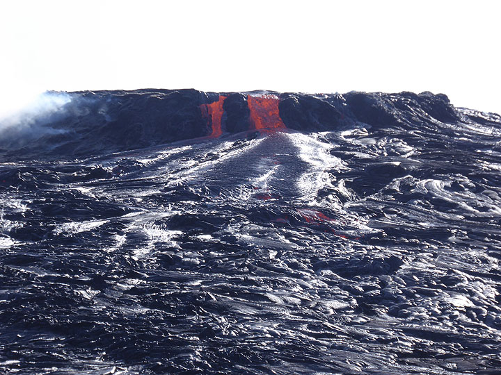 New lava is supplied from the active lava lake into pahoehoe lava flows that formed during an earlier overflow. (Photo: Hans and Jooske)