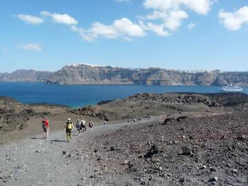 Geology students walking on the young Nea Kameini volcanic deposits with main island of Thira in the background, Santorini, 2010 (Photo: Ingrid)