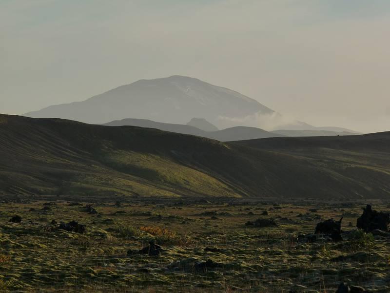 The contours of Mount Hekla materialising in the hazy evening light behind a volcanic ridge. Near  Hrauneyjalón, southern boundary of the Icelandic Highlands - 13 Septmeber 2014. (Photo: Ingrid)
