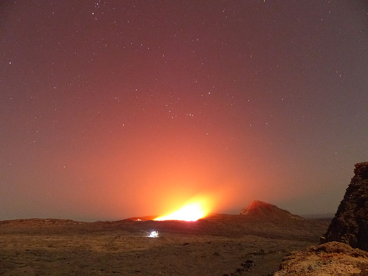 DAYS 5-6-7: Erta Ale - During the night, the strong glow above the churning lake competes with the stars. (Photo: Ingrid)