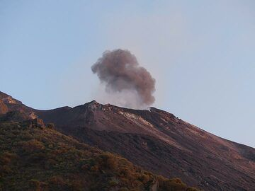 The volcano is very active and regular large explosions occur from the central part of the crater terrace, creating dark grey ash clouds which rise above the white degassing plume. (Photo: Ingrid)