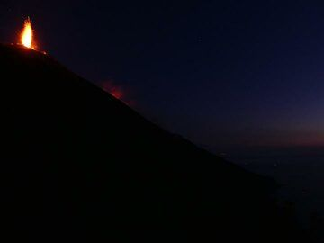 Nighttime view of the Sciara del Fuoco and the crater terrace with candle like eruption from the two eastern vents... (Photo: Ingrid)