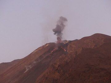 From this angle we can see the multiple overflows from the western side of the crater terrace as well as a larger explosion occurring from the central vent. (Photo: Ingrid)