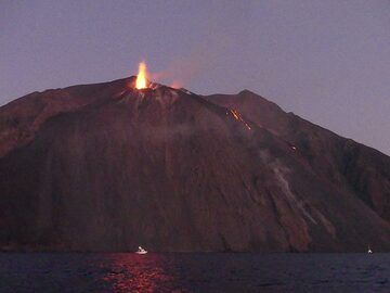 A strong candle like eruption from the two vents in the eastern area of the crater terrace is reflected deep red on the sea surface below the Sciara. (Photo: Ingrid)