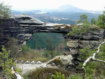 Pravčická brána, Europe's largest natural sandstone arch, and in the background Rùžovský vrch, an ancient extinct basaltic volcano and the highest mountain (619 m) in the Bohemian Switzerland east of the River Elbe in the Czech Republic (Photo: Janka)