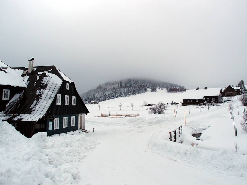 Deep winter in Jizerka with the extinct Bukovec volcano partly in clouds, Czech Republic (Photo: Janka)