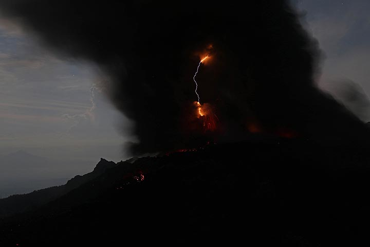 Ash eruption with volcanic lightning, from Gunung Ibu, View From Campsite,  Halmahera, North Maluku, Indonesia (Photo: Jay Ramji)