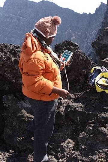 Volcanologist reading the temperature of a fumarole (Photo: Michael Wareham)