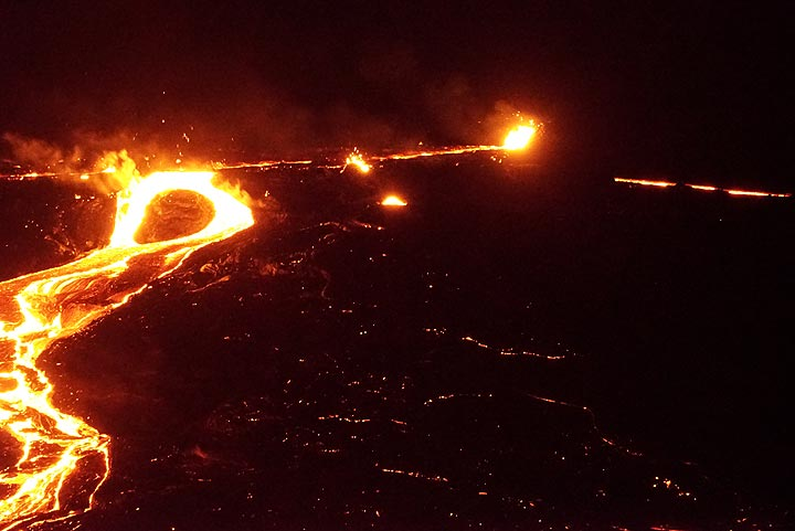 """Night-time view of the western overflow (16 Jan evening). In the background to the right, another lava flow is visible: """"In the afternoon other two lava rivers appeared on SW flank (the length ca 500 m)."""" (Richard) (Photo: Paul Reichert)"""