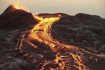 Close view of spattering at the breached rim of the overflowing lava lake and the lava river. (Photo: Paul Reichert)