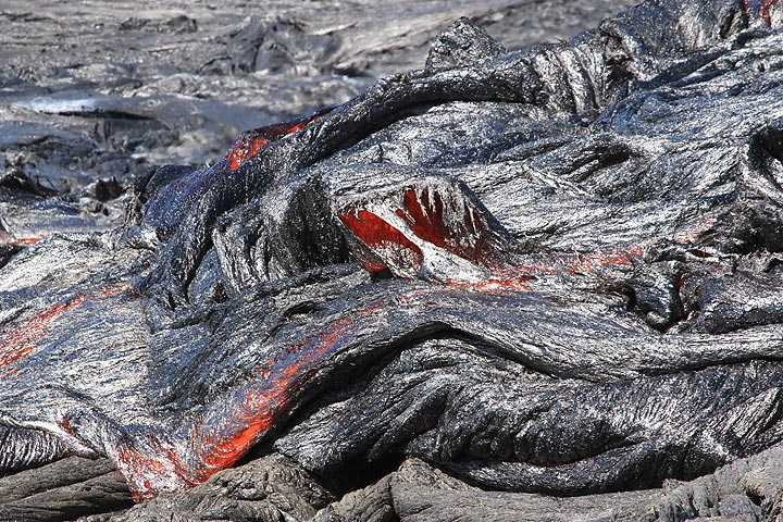 Further away, the flow front slowed down, forming shelly, thin-crusted silvery pahoehoe lava twisted and folded into abstract shapes, nature being the greatest artist of all. (Photo: Paul Reichert)