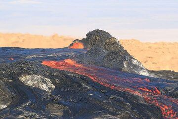 A small spatter rampart at the southern end of the lava lake's rim remains one of the only parts of the rim that is not being overflown by lava... (16 Jan). (Photo: Paul Reichert)