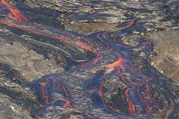Rivers of lava meandering on the caldera floor. (Photo: Paul Reichert)