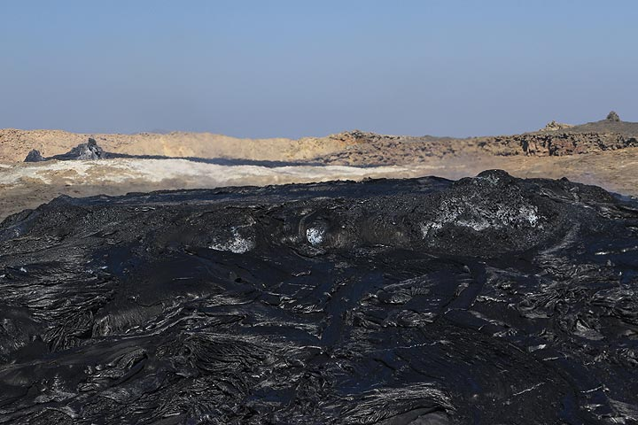 Another view of the inactive northern crater with a young lava field in the foreground and the prominent hornitos in the left background. (Photo: Paul Reichert)