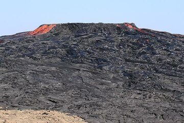 View (from NW) of the new lava shield produced during the past 2 months mainly, located at the place where there was once the southern pit crater with its lava lake inside. (Photo: Paul Reichert)