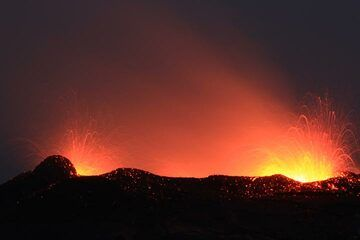 """""""When in high level, short time overflows appeared, when in low level the activity was similar to Strombolian one - there were the fountains reaching up to 50-60 m in height."""" (Richard) (Photo: Paul Reichert)"""