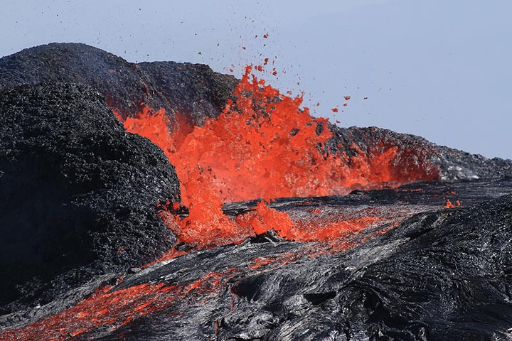Close-up of a violent fountaining phase at the northern end of the lava lake, where the liquid spatter rapidly accumulates to a new cone. (Photo: Paul Reichert)