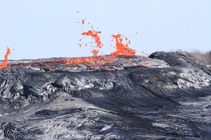 """19 Jan: """"Activity was the same as a previous day - big fountains with sporadic lava flows reaching 500 m and the fluctuating lake level +-15m. We were so tired of the lava observation we started looking at outer flanks of Erta Ale..."""" (Richard) (Photo: Paul Reichert)"""