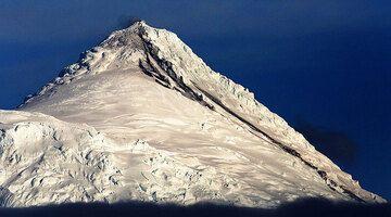 Heard Island volcano in eruption with dark lava flows on the snow, Nov 2015 (Photo: Richard Arculus)