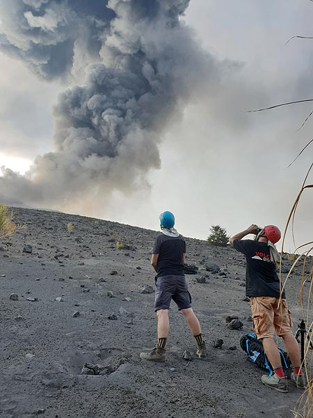 Watching an ash eruption from the end of the forest (Photo: Ronny Quireyns)