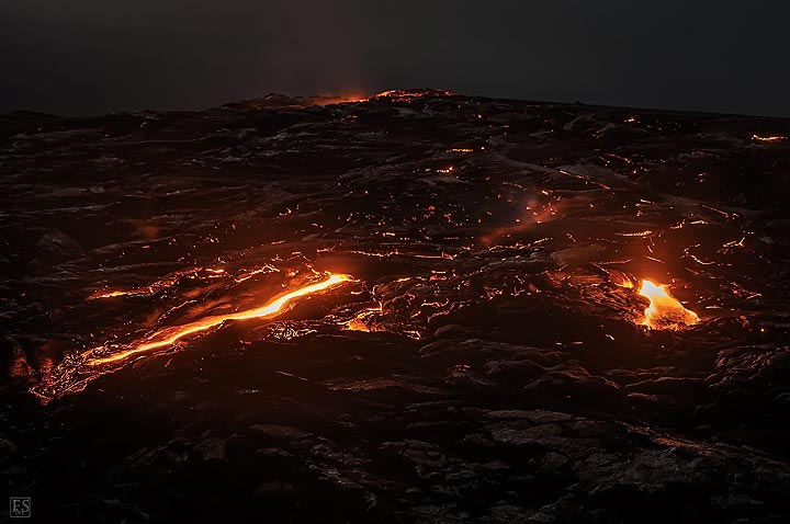 Nighttime view of the active lava shield at Erta Ale´s southern rift eruption in February 2017. (c)