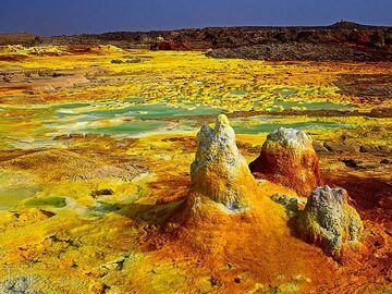 Yellow salt crusts with green acid ponds and small geysirs at Dallol hydrothermal area (c)