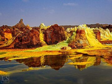 The alien yellow, green and brown landscape of the hydrothermal deposits and acid ponds at Dallol (c)