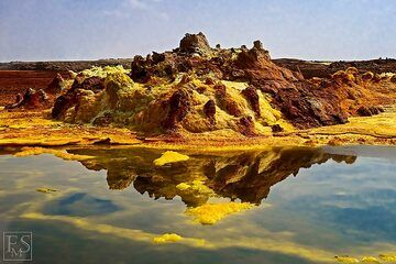 The interaction of heated groundwater with local rocks, salts and chemicals from magma at depth has created this unique and colourful landscape of bizarre salt deposits and acid ponds (c)