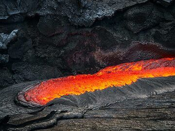 Cooled crusts gets consumed by actively boiling lava at the edge of the lake (Erta Ale fissure eruption) (c)