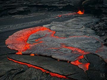 Fresh red hot lava covers the thin black crust of the lava lake (Erta Ale fissure eruption) (c)