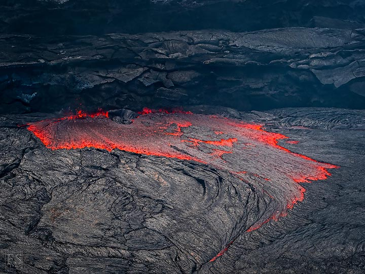 The lava lake at the Erta Ale fissure eruption is more like pond where on one side lava flows in whilst at this location lava is flowing out and continuing its travels underground (c)