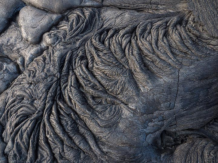 Beautiful ropes texture of cooled pahoehoe lava flow at Erta Ale's fissure eruption site (c)