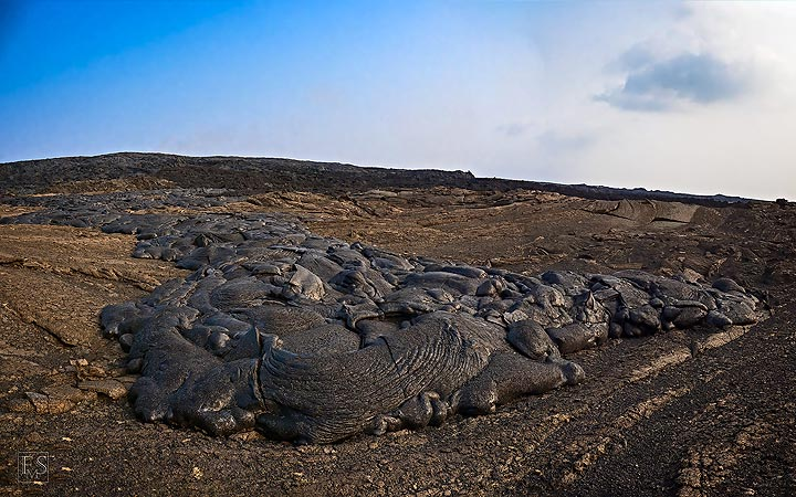 Fresher lava flows stand out in the landscape due to their silver hue and dark black crust (Erta Ale fissure eruption) (c)