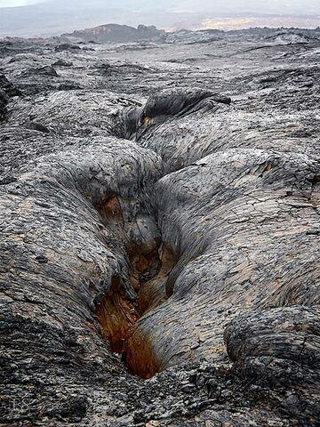 View along one of the many cracks on Erta Ale's slopes which at one point opened up and erupted lava in a fissure type volcanic activity (c)
